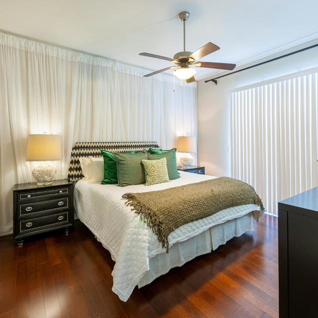 Bedrooms with hardwood floors at Ascent at City Centre Apartments in Houston