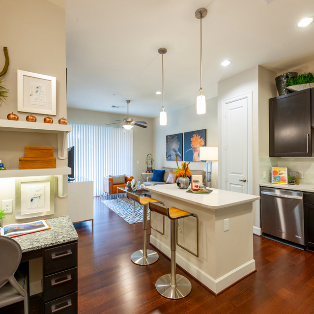 Kitchen with island seating at Ascent at City Centre Apartments in Houston