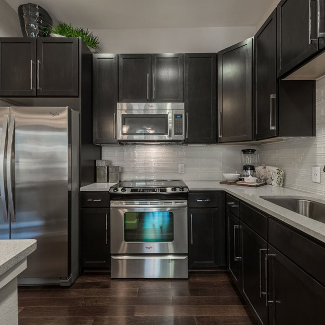 Kitchen with dark cabinets at Ascent at City Centre Apartments in Houston