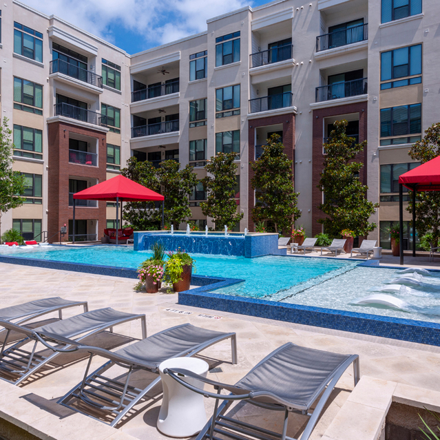 Outdoor pool area at Ascent at City Centre Apartments in Houston